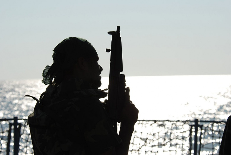 A member of Pakistan Navy Special Service Group is silhouetted by the setting sun aboard Pakistan Navy Ship PNS Babur. Wikimedia Commons/U.S. Navy