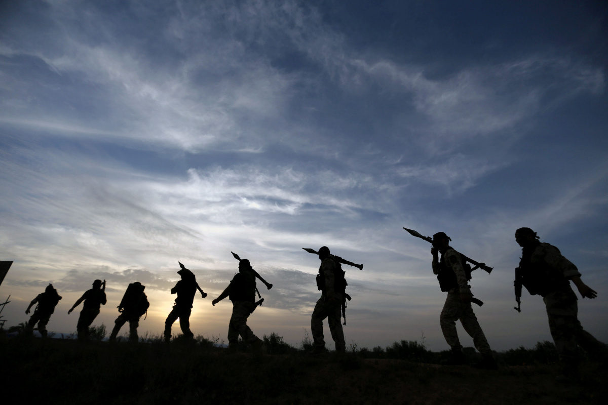 Palestinian Islamic Jihad militants march during a military drill in the southern Gaza Strip