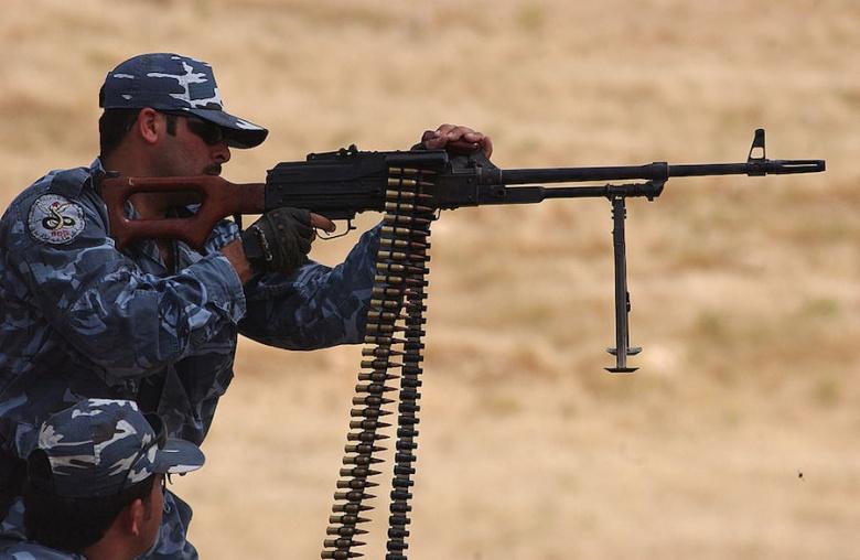 A Kurdish peshmerga officer fires a PKM in Mosul. Wikimedia Commons/U.S. Air Force