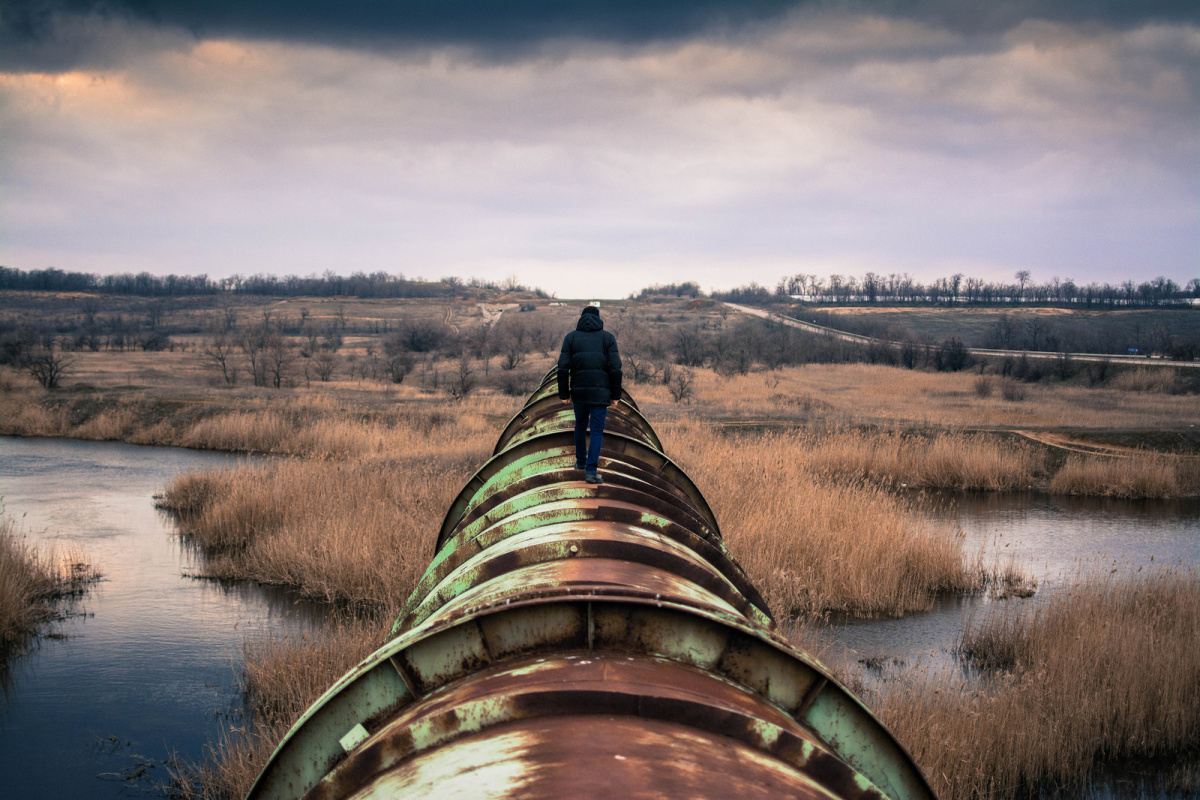 Man walking on pipeline. Flickr/Creative Commons/Lenny K Photography
