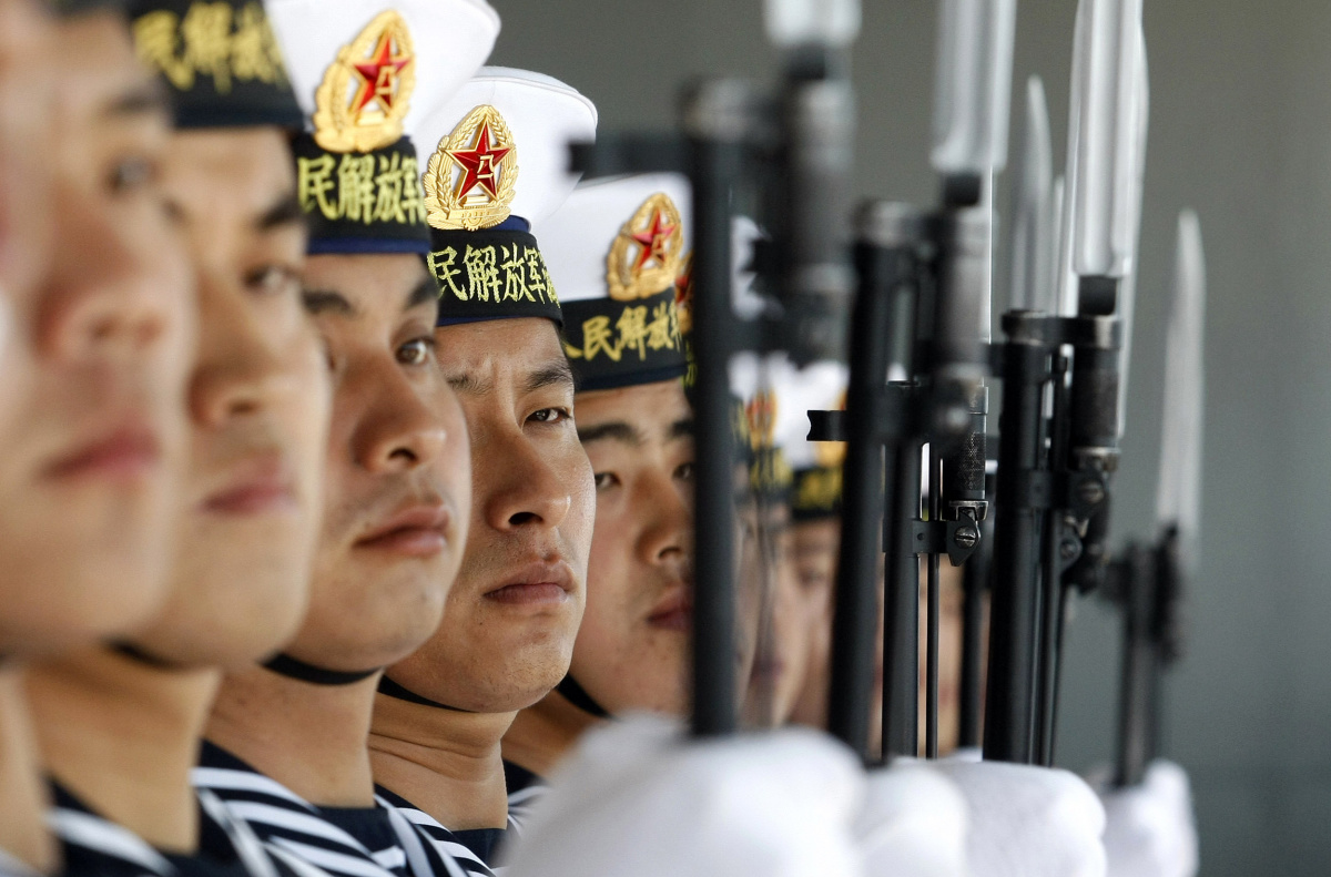Chinese sailors stand guard onboard the Shi Jia Zhuang, a Luzhou class missile destroyer, at Valparaiso port, about 75 miles (121km) northwest of Santiago
