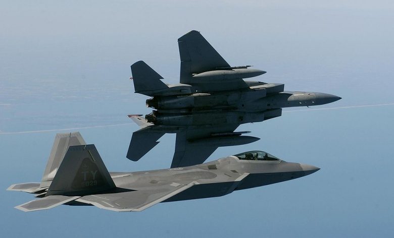 An F-22 and an F-15.