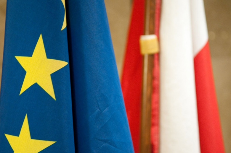 Flags of Poland and the EU. Wikimedia Commons/Michal Osmenda