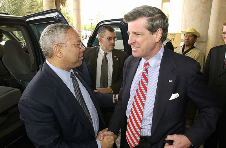 Colin Powell greets U.S. ambassador to Iraq Paul Bremer outside of the Coalition Provisional Authority Headquarters in Baghdad. Public domain/Department of Defense