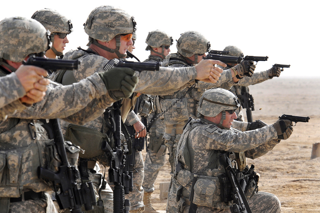 U.S. Army Soldiers participate in tactical range training using M-9 Beretta handguns. Flickr/U.S. Army