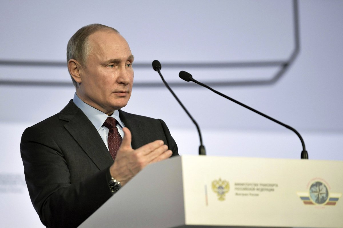 Russian President Putin delivers a speech during a conference of the Russian transport workers' union in Moscow