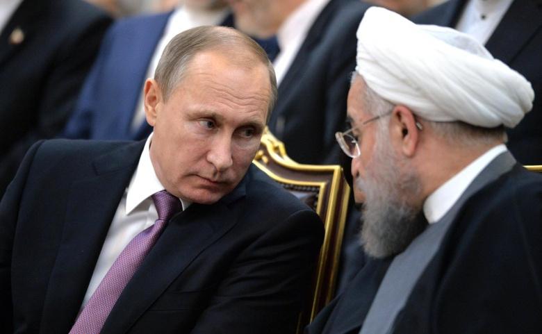 President Vladimir Putin meets with President Hassan Rouhani. Kremlin.ru