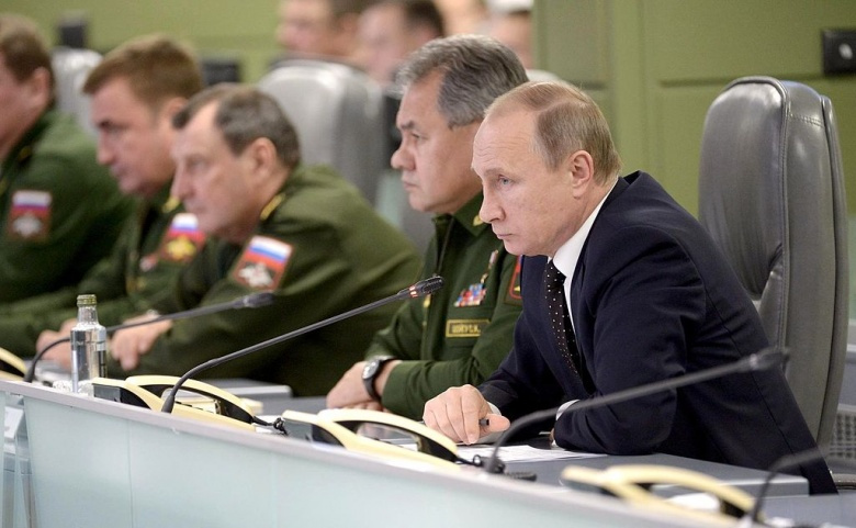 Vladimir Putin attends a meeting on Russia's Armed Forces actions in Syria. Wikimedia Commons/Kremlin.ru