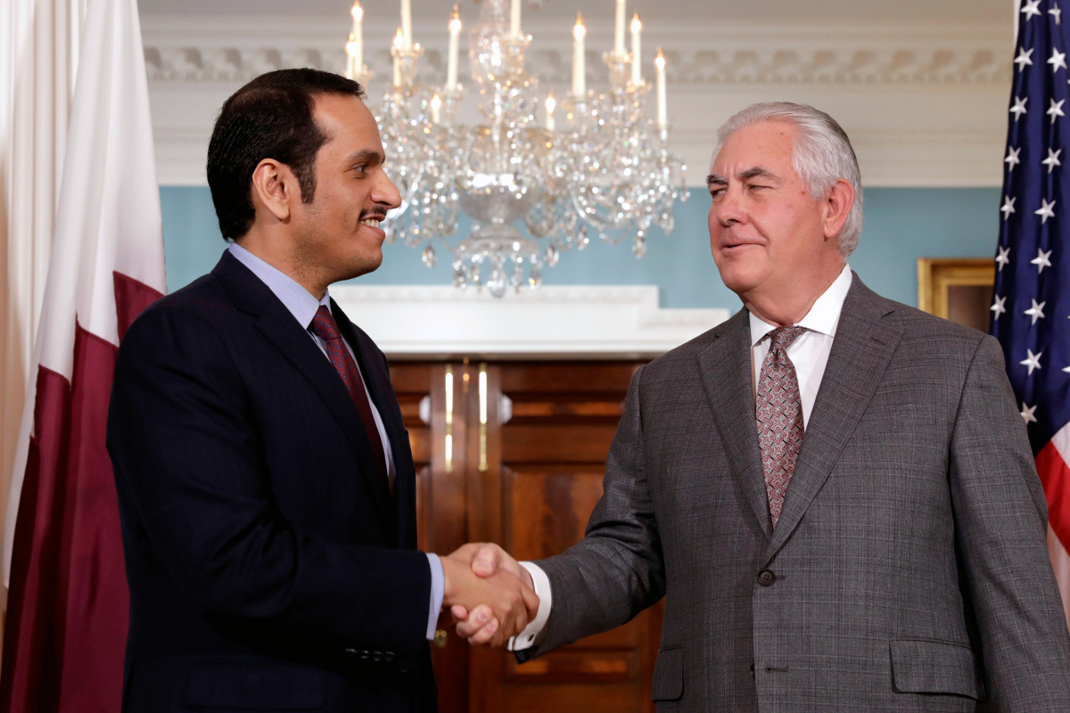 U.S. Secretary of State Rex Tillerson (R) shakes hands with Qatari Foreign Minister Sheikh Mohammed bin Abdulrahman Al Thani before their meeting at the State Department in Washington