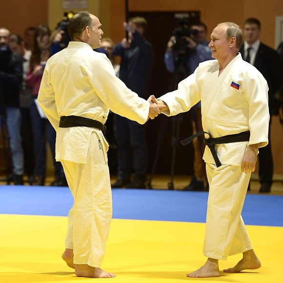 Image: Putin with the Russian Olympic Judo team in 2012. Kremlin photo.