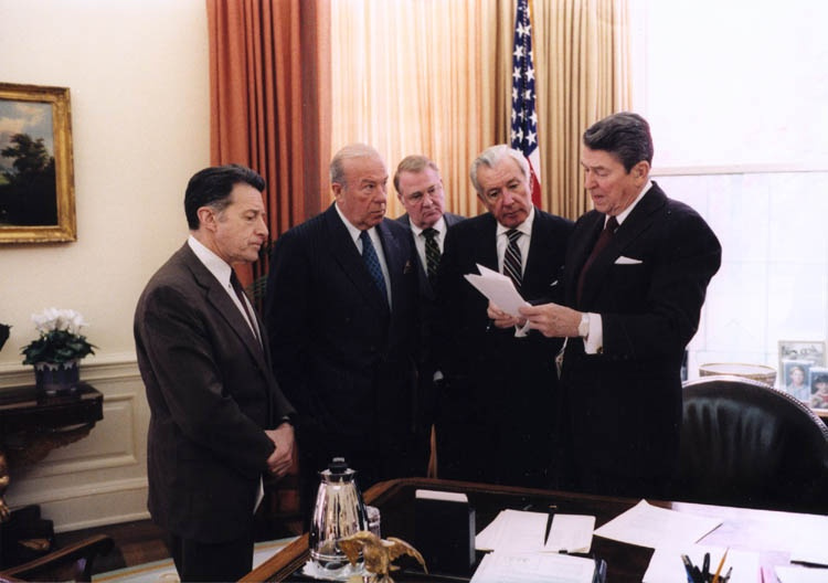 President Ronald Reagan with Caspar Weinberger, George Shultz, Ed Meese, and Don Regan. Wikimedia Commons/Public domain