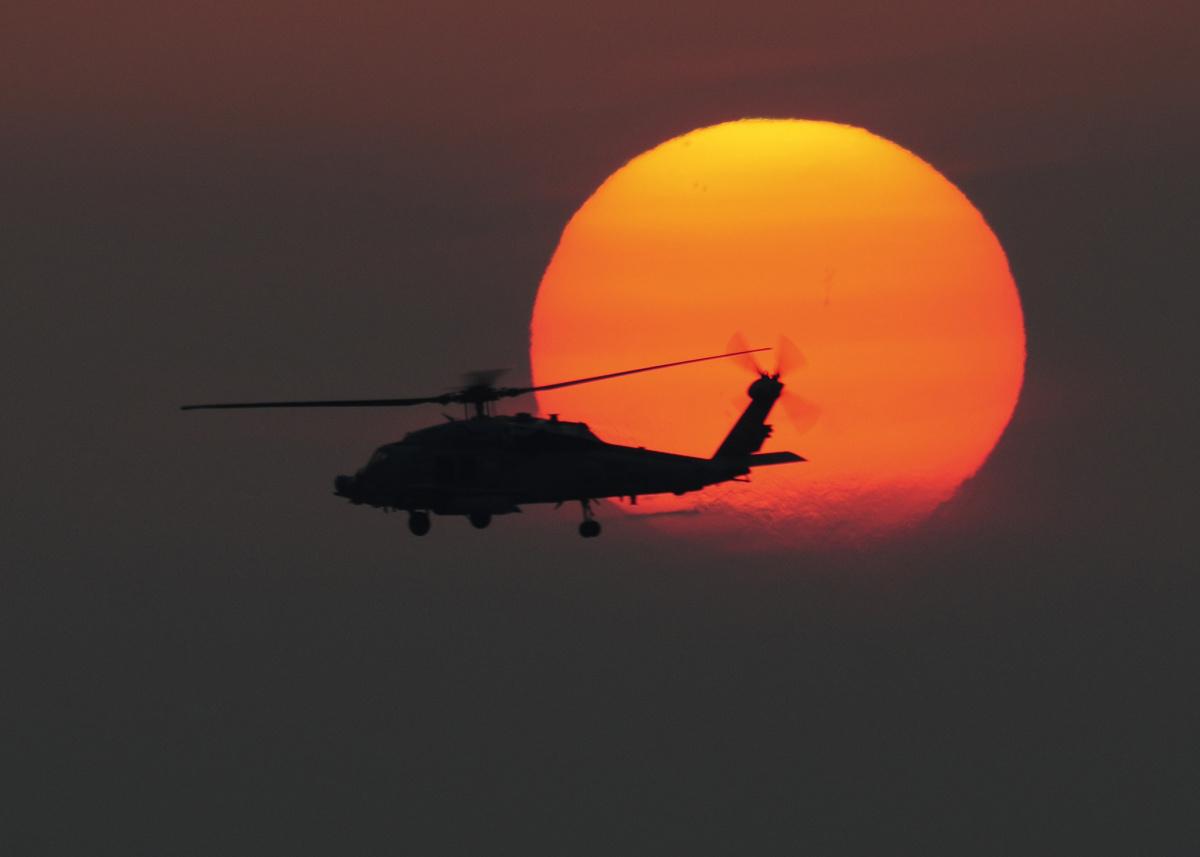 An HH-60H Sea Hawk helicopter flies over the flight deck of the aircraft carrier USS Dwight D. Eisenhower. Flickr/U.S. Navy