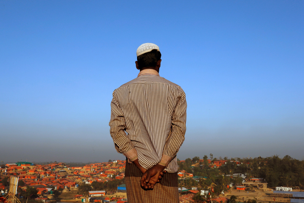 A Rohingya refugee looks at the view from a hill at Palong Khali refugee camp near Cox's Bazar