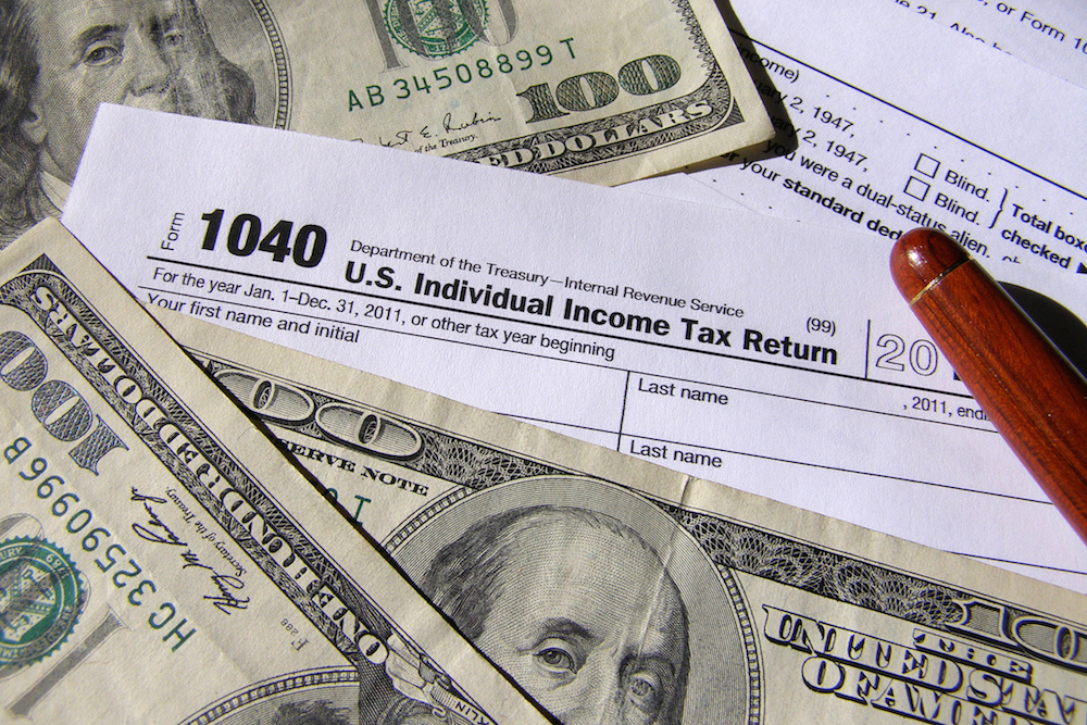 Hundred-dollar bills and 1040 tax form. Flickr/Creative Commons/ccPixs.com