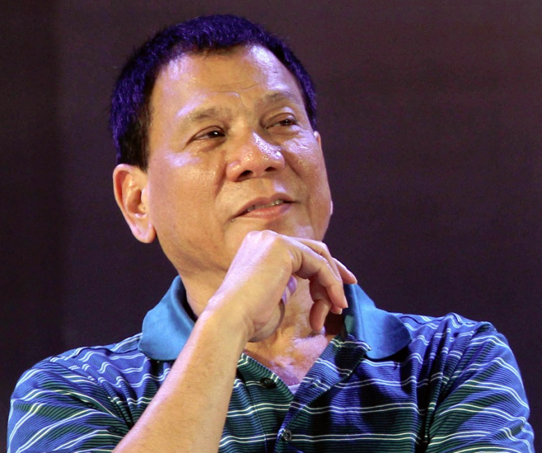 "Image: ""Cropped photo of Davao City Vice Mayor Rodrigo Duterte while conversing with President Benigno S. Aquino III during the Meeting with Local Leaders and the Community at the Rizal Park in San Pedro Street, Davao City on Wednesday (March 06, 2013)."""