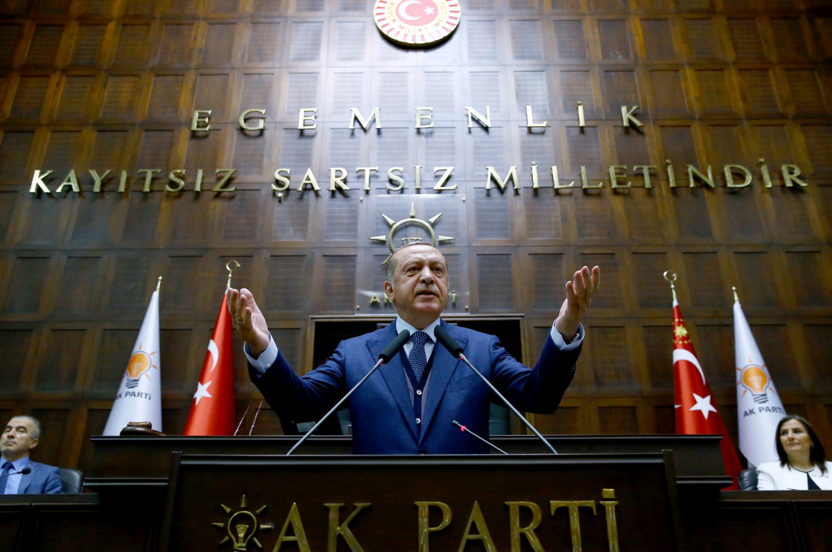 Turkish President Tayyip Erdogan addresses members of parliament from his ruling AK Party (AKP) during a meeting at the Turkish parliament in Ankara, Turkey, June 13, 2017. Kayhan Ozer/Presidential Palace/Handout