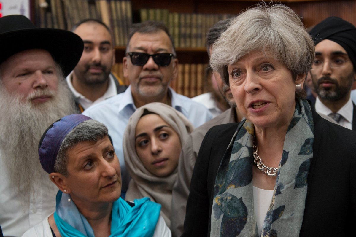 Britain's Prime Minister Theresa May speaks to faith leaders in Finsbury Park Mosque, near rthe scene of an attack, in London, Britain June 19, 2017. REUTERS/Stefan Rousseau/Pool