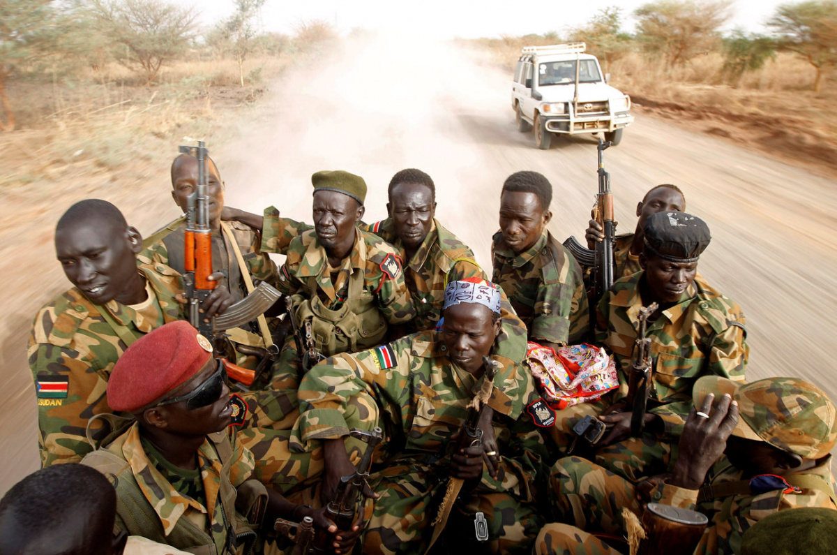 South Sudan's army, or the SPLA, soldiers drive in a truck on the frontline in Panakuach, Unity state April 24, 2012. REUTERS/Goran Tomasevic