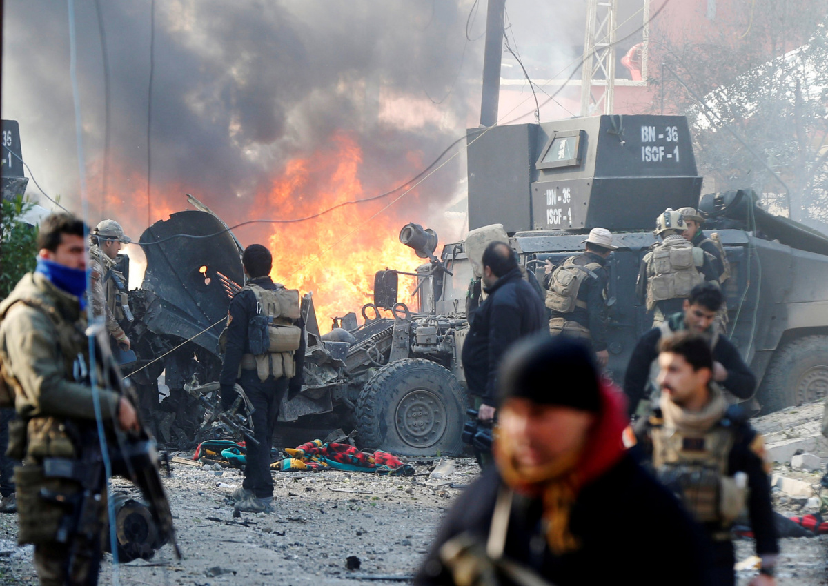 Iraqi Special Operations Forces react after a car bomb exploded during an operation to clear the al-Andalus district of Islamic State militants, in Mosul, Iraq, January 16, 2017. REUTERS/Muhammad Hamed/File photo