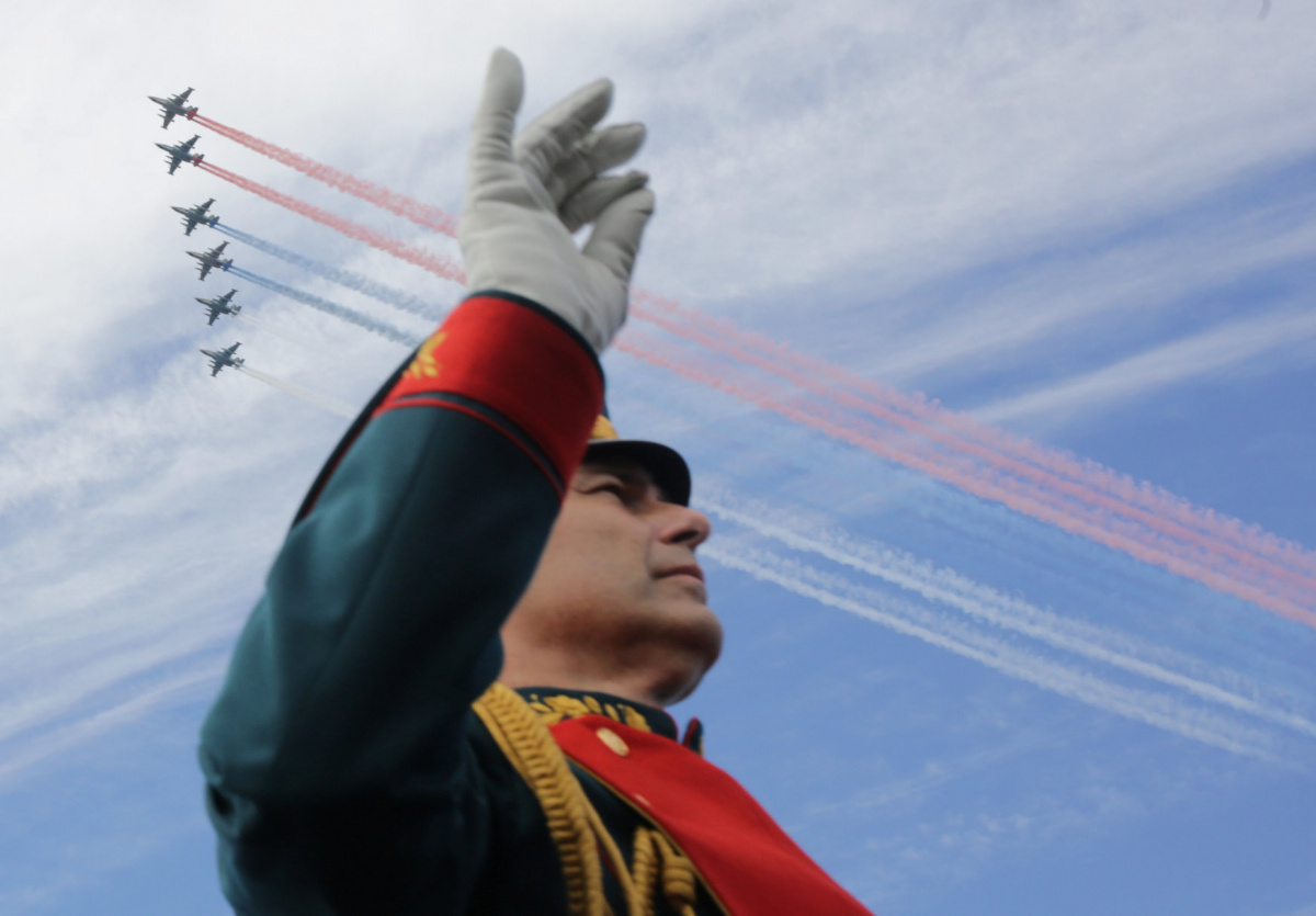 A member of a military band performs as Russian fighter jets fly in formation during the Navy Day parade in Kronshtadt, a seaport town in the suburb of St. Petersburg, Russia, July 30, 2017. REUTERS/Anton Vaganov​