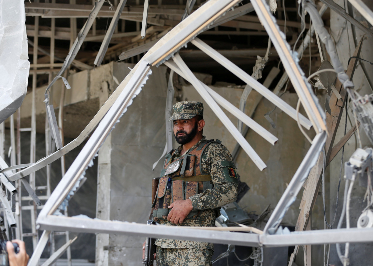An Afghan security force stands guard at the site of a suicide bomb attack in Kabul, Afghanistan August 29, 2017. REUTERS/Omar Sobhani