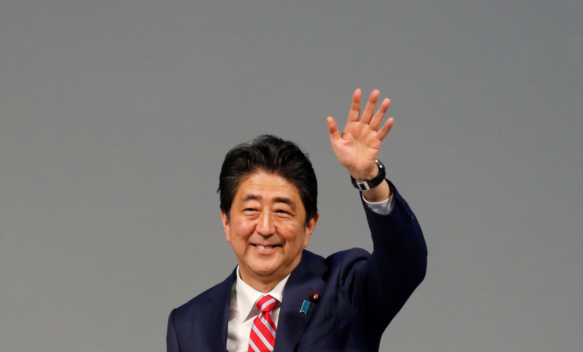 Japanese Prime Minister Shinzo Abe waves towards the delegates during the India-Japan Annual Summit, in Gandhinagar, India, September 14, 2017. REUTERS/Amit Dave