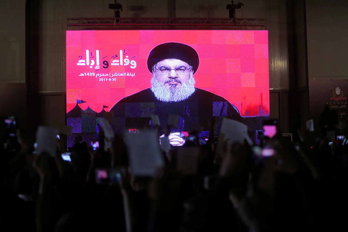 Lebanon's Hezbollah leader Sayyed Hassan Nasrallah is seen on a video screen as he addresses his supporters during a ceremony of the latest day of Ashoura in Beirut, Lebanon September 30, 2017. Picture taken September 30, 2017. REUTERS/Khalil Hasan​