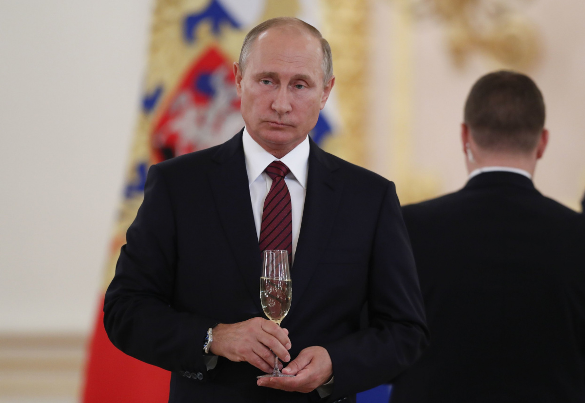 Russian President Vladimir Putin holds a glass of champagne during a ceremony to receive credentials from foreign ambassadors at the Kremlin in Moscow, Russia October 3, 2017. REUTERS/Pavel Golovkin/Pool