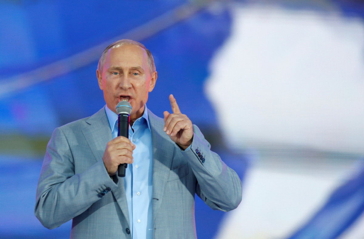 Russian President Vladimir Putin addresses participants of the 19th World Festival of Youth and Students during the closing ceremony at the Olympic Park in Sochi, Russia October 21, 2017. REUTERS/Alexander Zemlianichenko/Pool