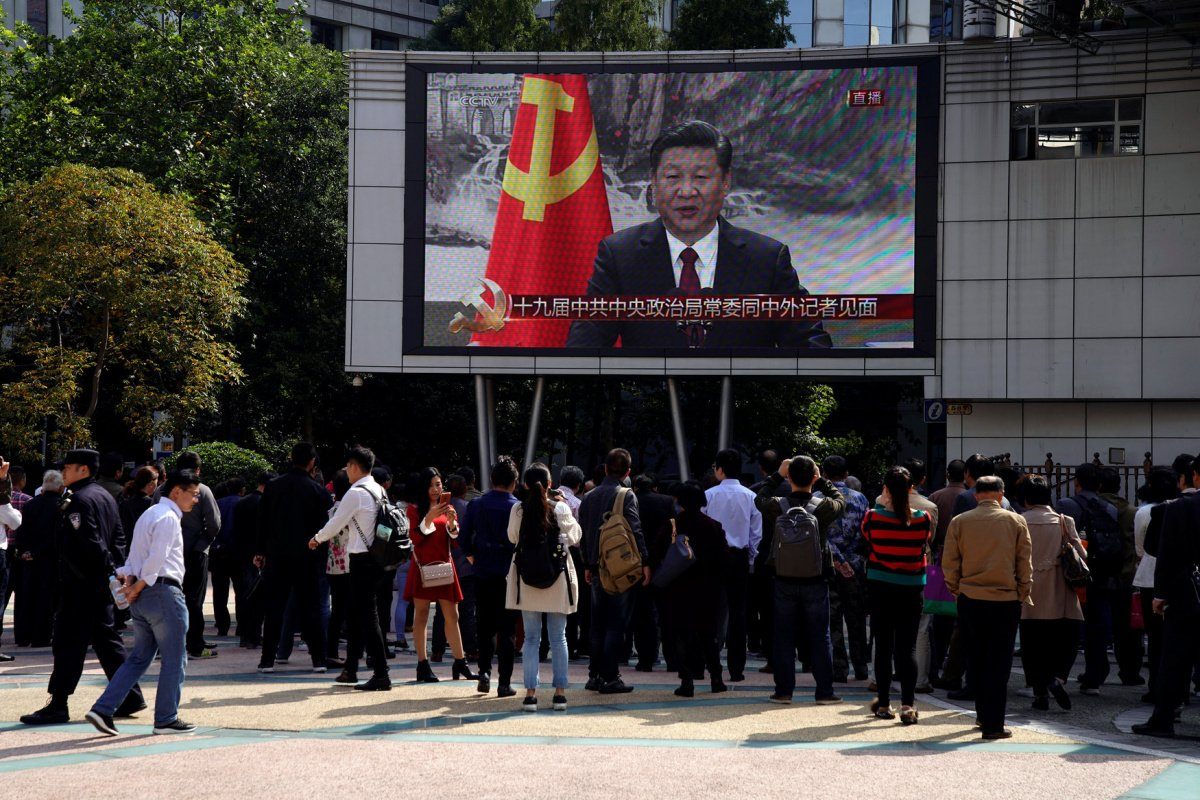 A TV screen shows a live news broadcast of Chinese President Xi Jinping introducing his Politburo Standing Committee after the 19th National Congress of the Communist Party of China, at the Nanjing pedestrian road in Shanghai, China, October 25, 2017. REUTERS/Aly Song