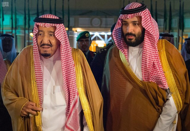 Saudi Arabia's King Salman bin Abdulaziz Al Saud walks with his son and Crown Prince Mohammed bin Salman, before King Salman leaves for Medina, in Riyadh, Saudi Arabia, November 8, 2017. Picture taken November 8, 2017.