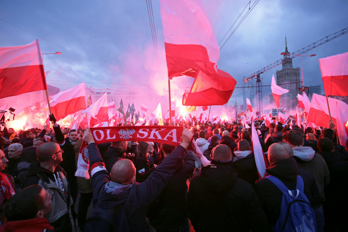 Protesters carry Polish flags and National Radical Camp flags during a rally, organised by far-right, nationalist groups, to mark 99th anniversary of Polish independence in Warsaw, Poland November 11, 2017.