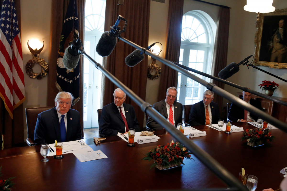 U.S. President Donald Trump talks with members of the press during a lunch with bicameral tax conferees in the Cabinet Room of the White House in Washington D.C., U.S. December 13, 2017. REUTERS/Carlos Barria