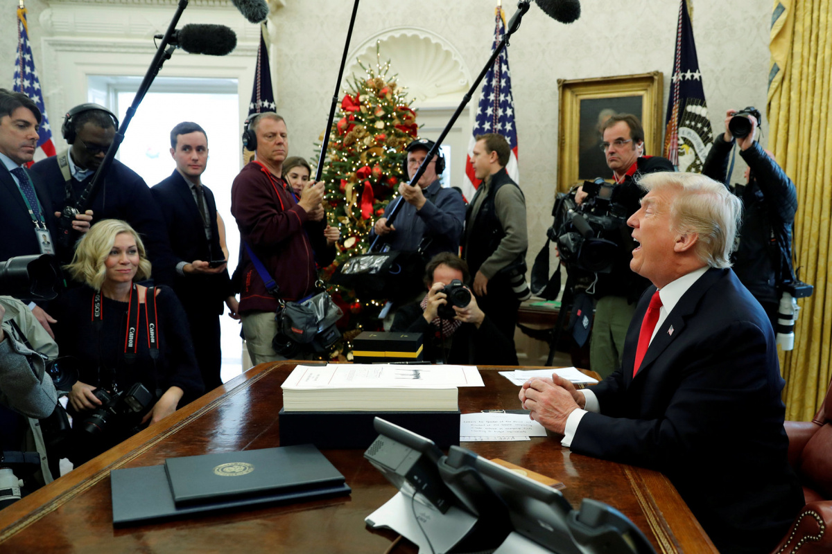 Image: U.S. President Donald Trump delivers remarks after signing sweeping tax overhaul legislation into law in the Oval Office at the White House in Washington, U.S. December 22, 2017. REUTERS/Jonathan Ernst