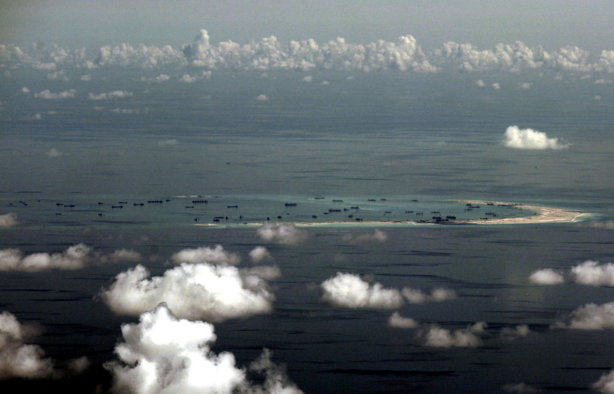 An aerial photo taken though a glass window of a Philippine military plane shows the alleged on-going land reclamation by China on Mischief Reef in the Spratly Islands in the South China Sea, west of Palawan, Philippines, May 11, 2015. REUTERS/Ritchie B. Tongo/Pool/File Photo