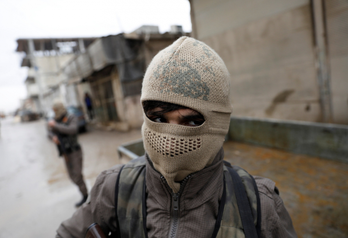Members of Turkey-backed Free Syrian Army police forces patrol in Azaz, Syria January 26, 2018. REUTERS/Umit Bektas