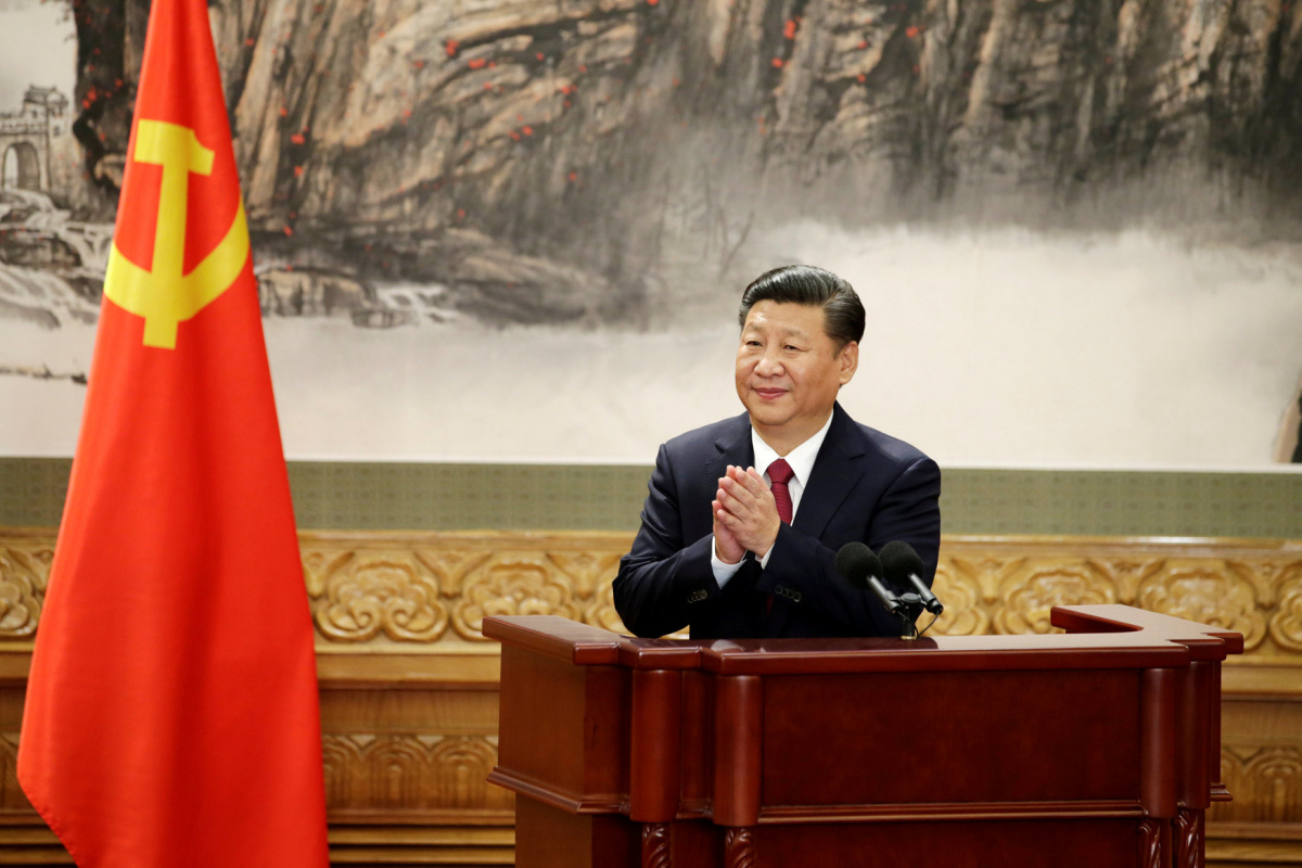 Chinese President Xi Jinping claps after his speech as China's new Politburo Standing Committee members meet with the press at the Great Hall of the People in Beijing, China October 25, 2017. REUTERS/Jason Lee/File Photo