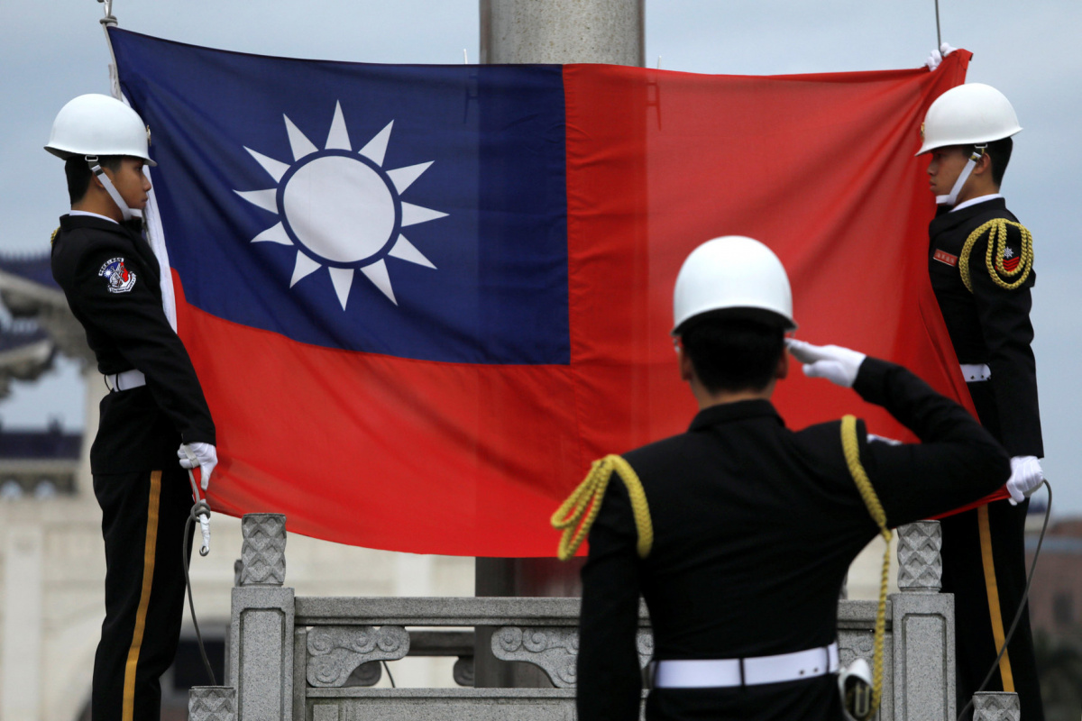 Military honour guards attend a flag-raising ceremony at Chiang Kai-shek Memorial Hall, in Taipei, Taiwan March 16, 2018. REUTERS/Tyrone Siu