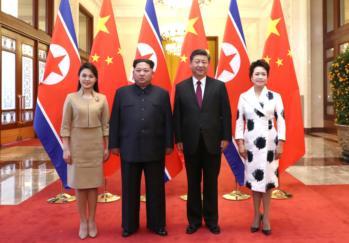 North Korean leader Kim Jong Un and wife Ri Sol Ju pose for a picture with Chinese President Xi Jinping and wife Peng Liyuan at the Great Hall of the People in Beijing, China in this picture released to Reuters on March 28, 2018. Ju Peng/Xinhua via REUTERS