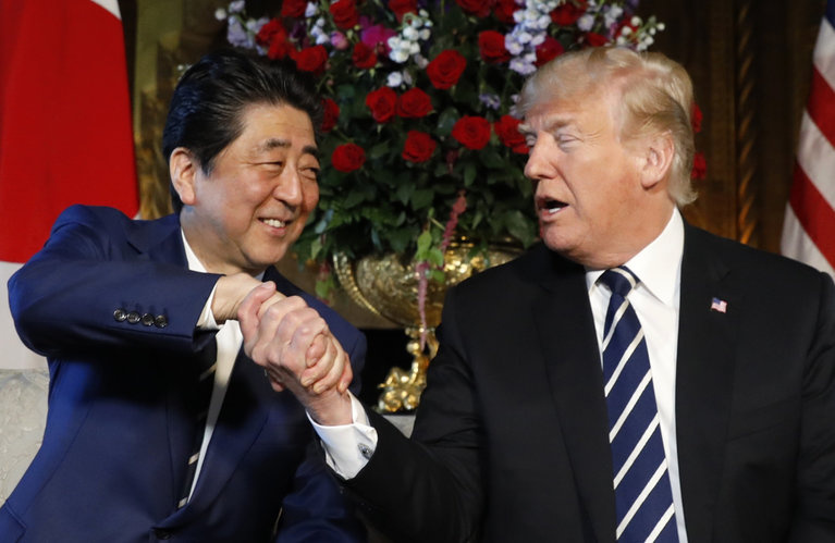 U.S. President Donald Trump greets Japan's Prime Minister Shinzo Abe during their bilateral meeting at Trump's Mar-a-Lago estate in Palm Beach, Florida U.S., April 17, 2018. REUTERS/Kevin Lamarque