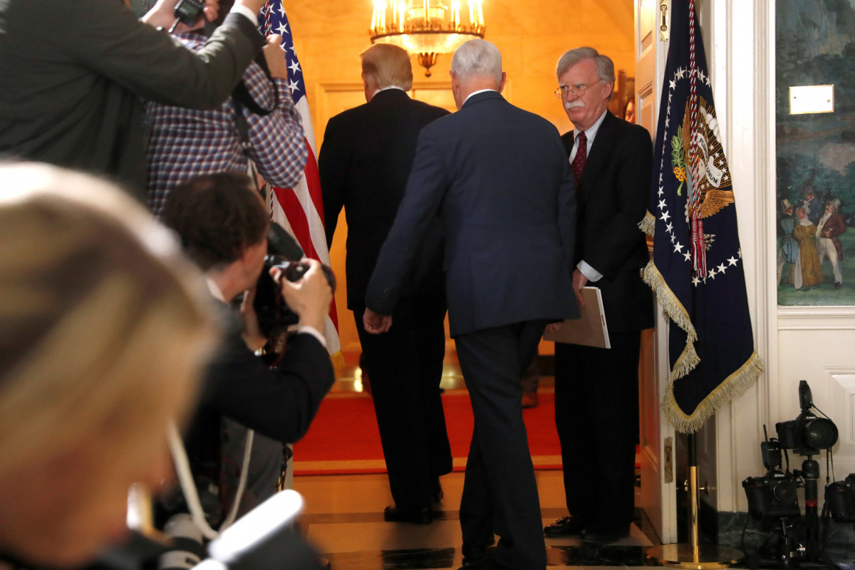 White House National Security Advisor John Bolton (R) departs with U.S. President Donald Trump and Vice President Mike Pence after Trump announced his intention to withdraw from the JCPOA Iran nuclear agreement during a statement in the Diplomatic Room at the White House in Washington, U.S. May 8, 2018. REUTERS/Jonathan Ernst