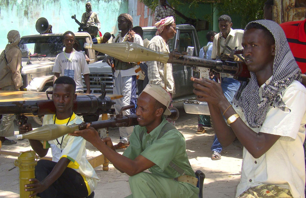 Somali fighters belonging to Ahlusunah warjama, a moderate sect fighting against the hardline al-Shabaab insurgents, display weapons during a parade in Mogadishu July 31, 2010. Al-Shabaab, which is linked to Al Qaeda, controls much of southern Somalia and is fighting to topple the Western-backed government in the lawless Horn of Africa nation. REUTERS/Omar Faruk