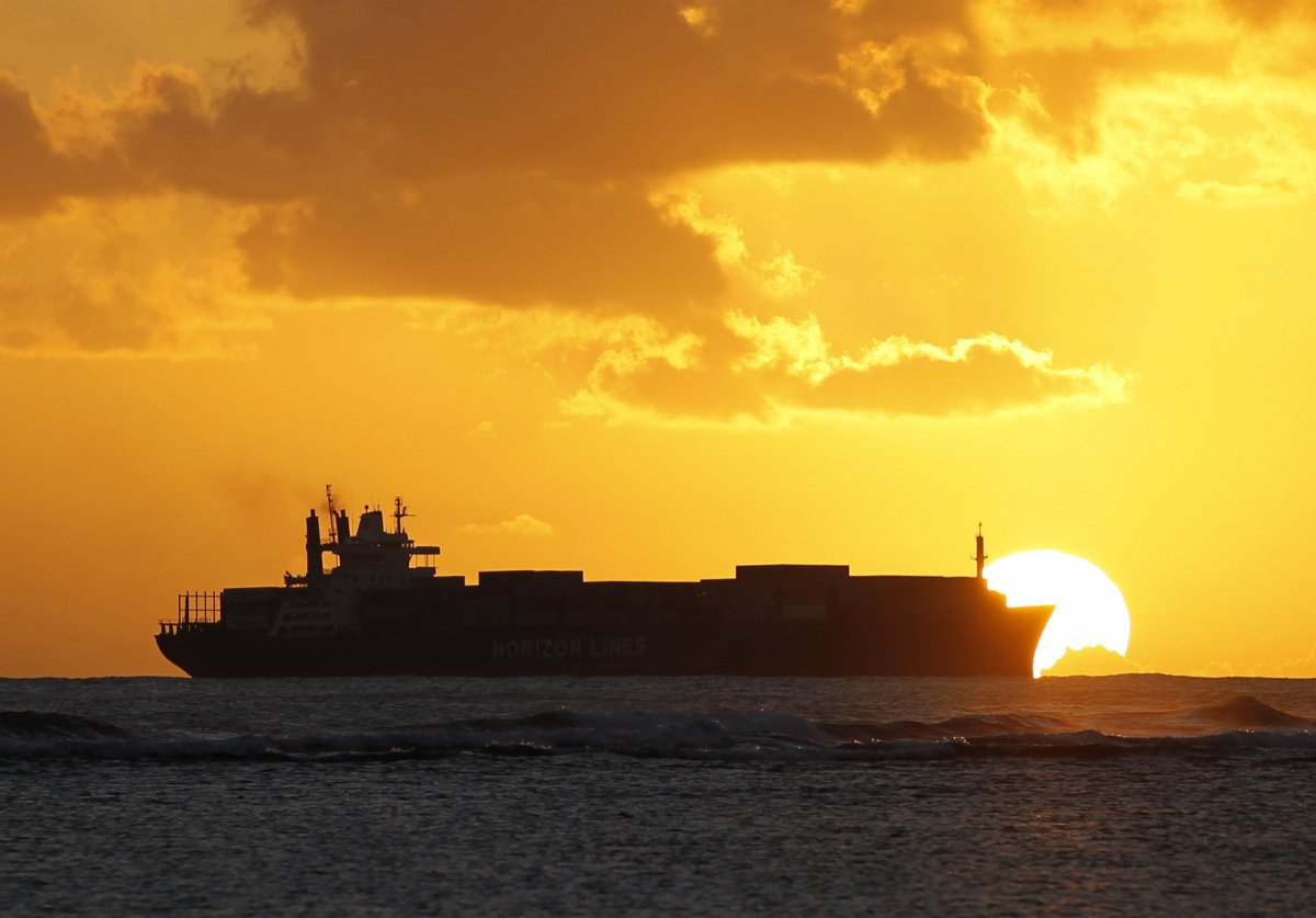 A cargo ship cruises as the sun sets at Ala Moana beach ahead of the Asia-Pacific Economic Cooperation (APEC) meeting in Honolulu November 7, 2011. Leaders of major nations bordering the Pacific will meet from Wednesday to Sunday in Hawaii to discuss building a regional free trade area and an environmental initiative to help spur world economic growth. REUTERS/Yuriko Nakao