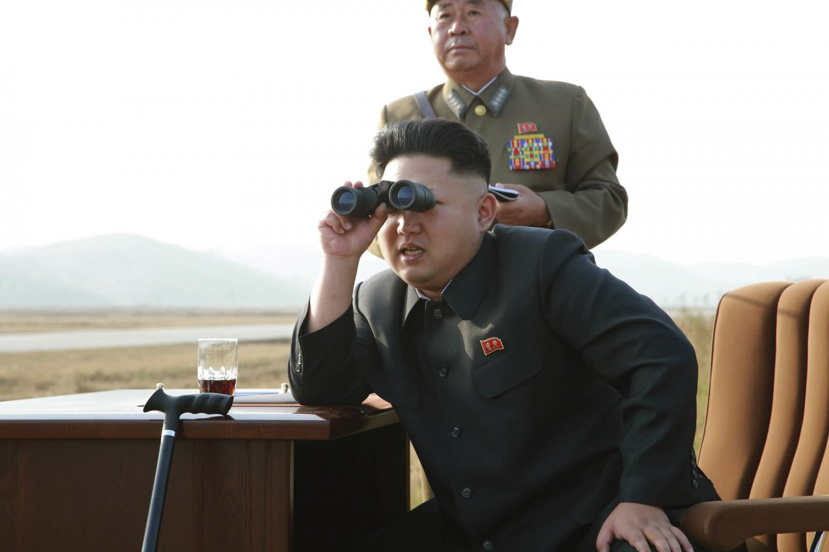 North Korean leader Kim Jong Un looks through a pair of binoculars as he guides a flight drill for the inspection of airmen of the Korean People's Army (KPA) Air and Anti-Air Force in this undated photo released by North Korea's Korean Central News Agency (KCNA) in Pyongyang October 30, 2014. REUTERS/KCNA