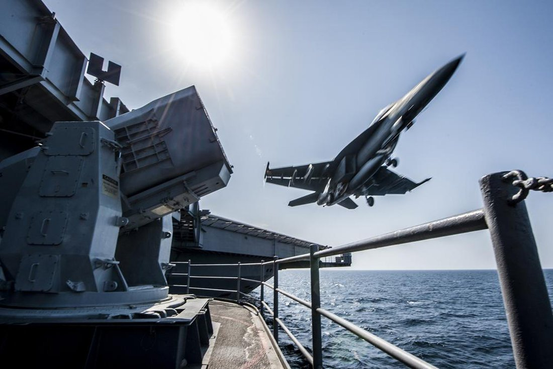 A U.S. Navy F/A-18 launches from the USS Carl Vinson in this undated handout picture released November 1, 2014. U.S.-led air strikes hit Islamic State positions around Kobani earlier in the day in an apparent effort to pave the way for the heavily-armed Kurdish contingent to enter. REUTERS/US Navy/Handout