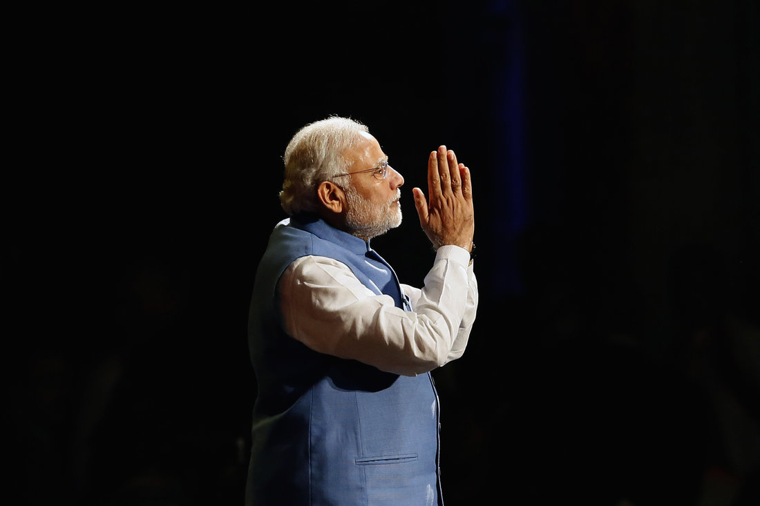 India's Prime Minister Narendra Modi reacts as he speaks to members of the Australian-Indian community during a reception at the Allphones Arena located at Sydney Olympic Park in western Sydney November 17, 2014. Modi is on a three-day offcial visit to Australia following the G20 leaders summit which was held in Brisbane over the weekend. REUTERS/Rick Stevens​