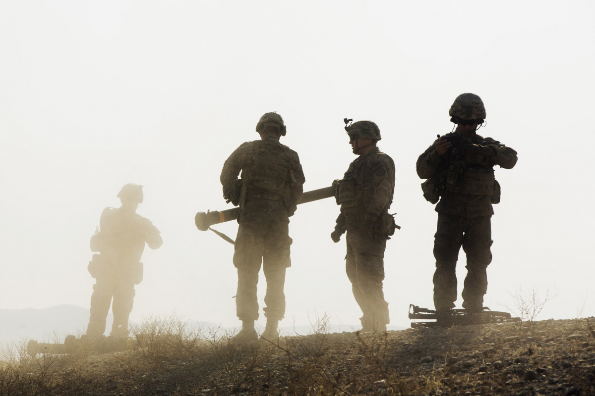 U.S. soldiers from D Troop of the 3rd Cavalry Regiment walk on a hill after finishing with a training exercise near forward operating base Gamberi in the Laghman province of Afghanistan December 30, 2014. REUTERS/Lucas Jackson