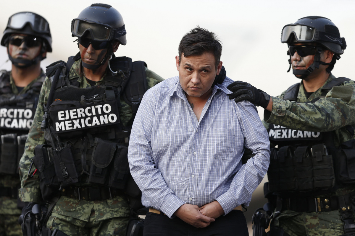 "Omar Trevino Morales, known as ""Z-42"" and leader of the Zetas drug cartel, is escorted by soldiers during a media conference about his arrest in Mexico City March 4, 2015. REUTERS/Edgard Garrido"