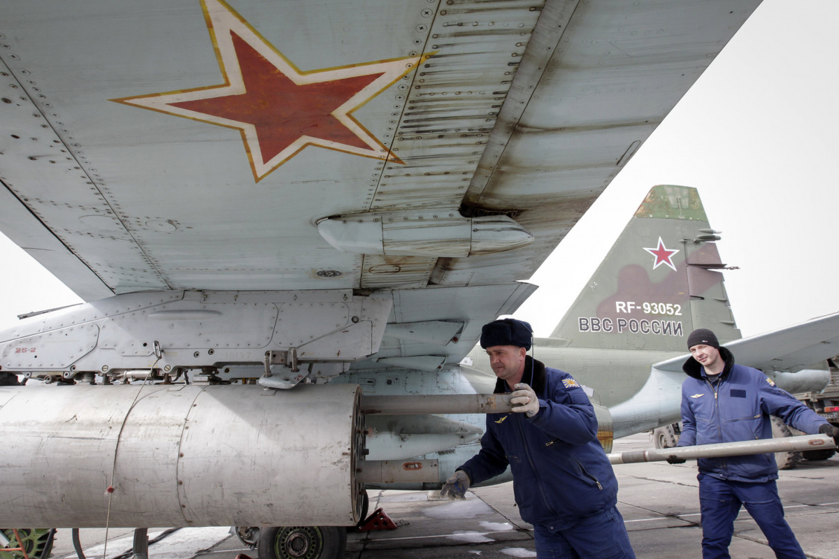 Servicemen load air-to-ground missiles onto a Sukhoi Su-25 jet fighter during a drill at the Russian southern Stavropol region, March 12, 2015. Russia has started military exercises in the country's south, as well as in Georgia's breakaway regions of South Ossetia and Abkhazia and in Crimea, annexed from Ukraine last year, news agency RIA reported on Thursday, citing Russia's Defence Ministry. REUTERS/Eduard Korniyenko