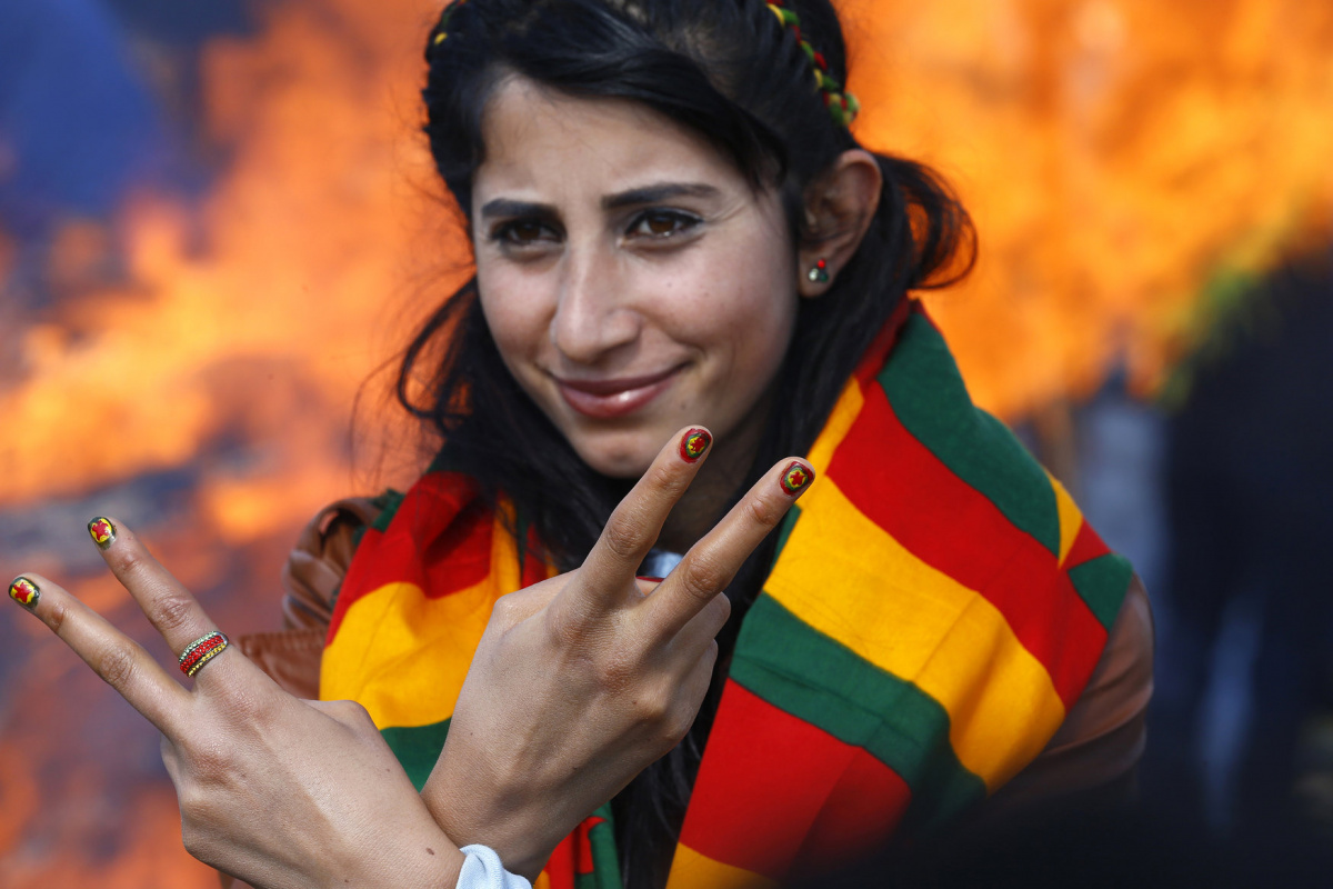 A woman shows off her nails after being painted with the colours of the flag of Kurdistan Workers Party (PKK) during a gathering celebrating Newroz, which marks the arrival of spring and the new year, in the border town of Suruc, Sanliurfa province March 17, 2015. REUTERS/Umit Bektas